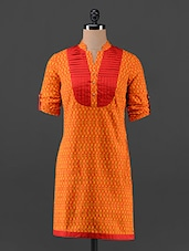 Orange Pintucked Yoke Roll-up Sleeves Kurti - AKYRA