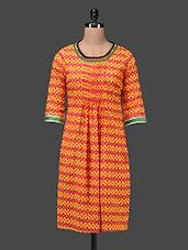 Yellow-Orange Printed Round Neck Cotton Kurti - Taaga