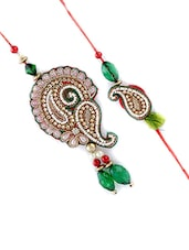 Multi Colored Fabric Rakhi - By