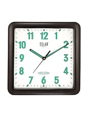 White Plastic Wall Clock With Solar Night Glow (11 Inches) - By