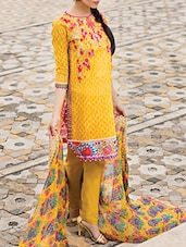 Yellow cotton embroidered unstitched suit set -  online shopping for Dress Material