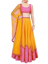 yellow faux silk lehenga -  online shopping for lehengas