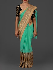 Embellished Turquoise And Brown Satin Saree - Pothys