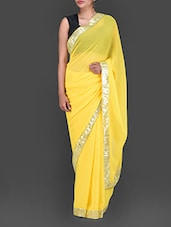 Yellow Georgette Saree With Sequined Border - Bollywood Designz