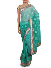 Shaded Teal Printed Saree With Gold Border - By
