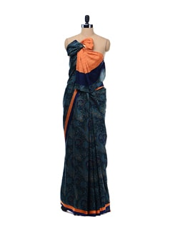 Blue Printed Crepe Saree With Orange Border. - Garden