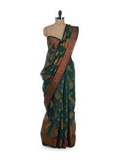 Bottle Green Saree With Elegant Cut Work Motifs - Bunkar