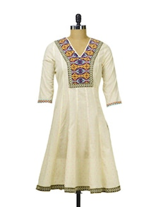 Cream Flared Kurta With Embroidered Yoke - Paislei