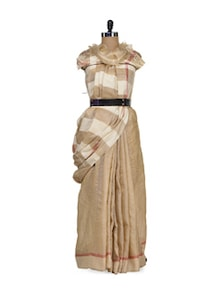 Beige Tusser Silk Saree With Delicate Pink Border - Eco Stree