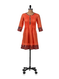 Bright Orange Kurti With A Pleated Silhouette - JUGNU