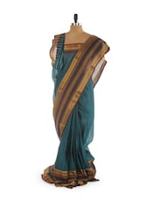Zari embellished teal saree