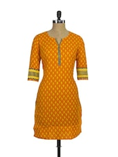 Bright Orange Printed Casual Cotton Kurti - Purab Paschim