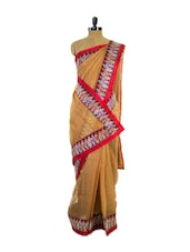 Glamorous Beige Super Net Saree With Stunning Red Border - Pothys