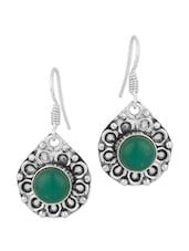 Dainty Pair Of Dangler Earrings With Floral Motif Encrusted With Green Colored Stone - Voylla