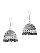 Scintillating Pair Of Dome Shape Jhumki Earrings With Black Beads - Voylla