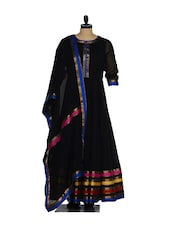 Elegant Black Anarkali With Multi-coloured Base,  Cotton Churidar And A Net Dupatta - Nataasha Dubliish