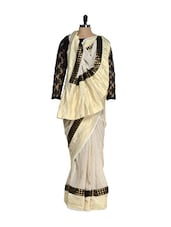 Beige And Black Hand-woven Silk Tussar Saree With A Georgette Net Lace Blouse And Lycra Underskirt - Nataasha Dubliish