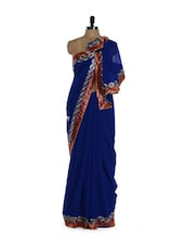 Stunning Blue Saree With Red Border In Georgette - Purple Oyster