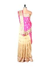 Cream And Pink Jacquard And Net Sari With Zari Embroidery, With A Matching Blouse Piece - Saraswati