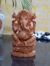Statue Of Lord Ganesha Carved In Kadam Wood - ECraftIndia