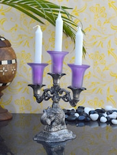 Alluring White Metal Candle Stand - ECraftIndia
