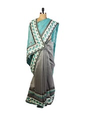 Gorgeous Green And Grey Super Net Saree With Resham Embroidery, Patch Border And Matching Grey Blouse. - Drape Ethnic