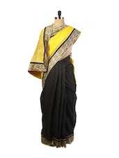 Graceful Yellow And Black Super Net Saree With Resham Embroidery, Patch Border And A  Matching Black Blouse. - Drape Ethnic