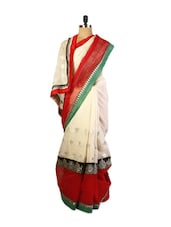 Beautiful Cream Super Net Saree With Zari Embroidery, Patch Border And A Matching Red  Blouse. - Drape Ethnic