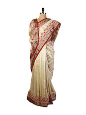 Elegant Beige Art Silk Saree With Zari Embroidery, Stone Work, And A Patch Border, A  Red  Art Silk Blouse. - Drape Ethnic