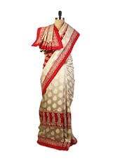 Beautiful Beige And Red Art Silk Saree With Zari Embroidery, Patch Border And A Beige Art Silk Blouse. - Drape Ethnic