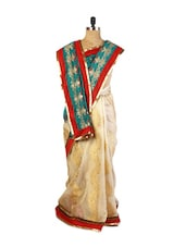 Gorgeous Combination Of Green And Beige Art Silk Saree With  Zari And Resham Embroidery, Patch Border And A Matching Red Blouse. - Drape Ethnic