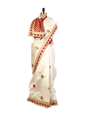Elegant Cream  Art Silk Saree With Zari And Resham Embroidery, Patch Border And A Matching Red Blouse. - Drape Ethnic