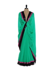 Green Georgette Saree With Black Sequined Blouse - Purple Oyster