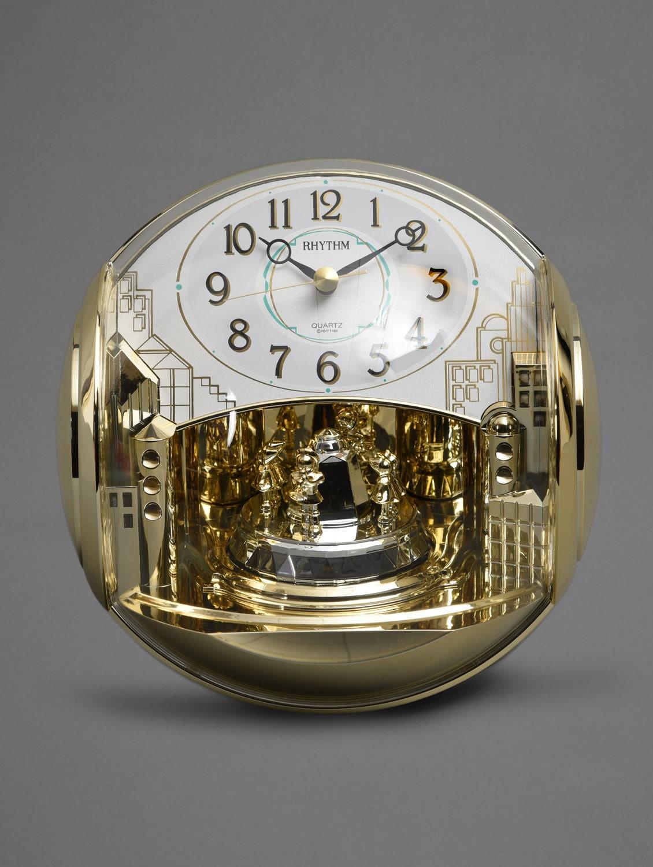 Gold Domed Art Deco Motion Table Clock - Rhythm