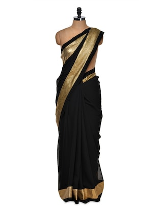 Luxe black saree with gold border