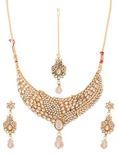 Gold And White Stone-studded Necklace, Earrings And Maangtika Set - Vendee Fashion