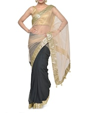 Fantastic Black And Gold Shaded Net Saree With Glamorous Golden Border - Aakriti
