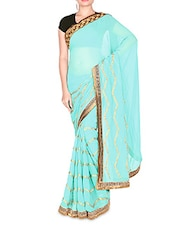 Turquoise Embroidered Crepe Jacquard Saree - By