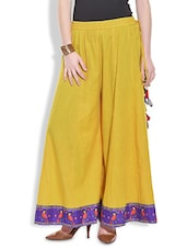 Yellow Flared Palazzos With Printed Hem - By