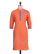 orange embroidered quarter sleeved cotton kurti -  online shopping for kurtas