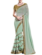 Mint Green Satin Georgette Embellished Sari - By