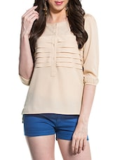 Peach Horizontal Round Neck Three-quarter Sleeved Pleated Top - ZOVI