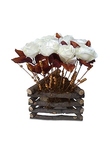 white artificial roses with vase