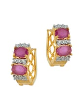 Exotic Oval Design Gold Plated Earrings Studded With CZ And Pink Color Stones - Voylla