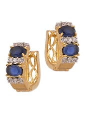 Pair Of Gold Plated Hoop Earrings Decorated With Shiny CZ And Blue Color Stones - Voylla