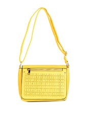 Yellow Leatherette Cut Work Clutch - Daphne
