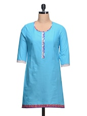 Round Neck Solid Blue Cotton Kurti With Paisley Printed Border - Taaga