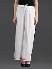 White Cotton Palazzo Pants With Red Embroidery - Bhama Couture