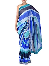 Embellished And Abstract Printed Blue Poly Georgette Saree - By