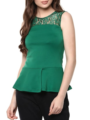 2f7040f5 Buy Dark Green Sleeveless Peplum Top for Women from The Vanca for ₹400 at  60% off | 2019 Limeroad.com